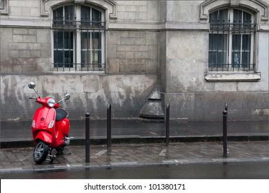 Retro red scooter in Paris street