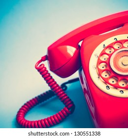 Retro Red Telephone on Blue Background