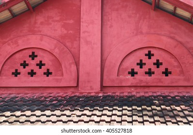 Retro red tile roof of old house