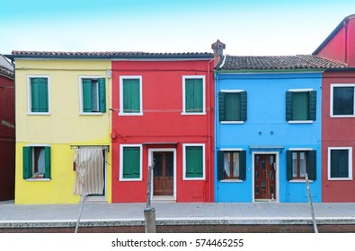Retro residential houses with bright colorful facades