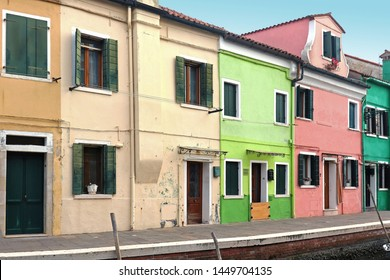 Retro residential houses with colorful facades and old doors and windows