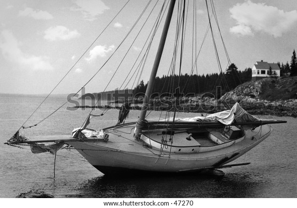 Retro restored photo from a 1920's negative of a beached boat