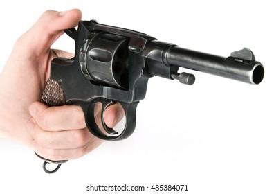 retro revolver in a hand isolated on white background