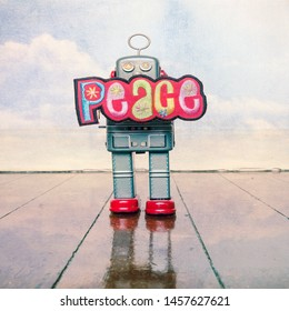 retro robot holds up a pice sign standing on a old wooden floor