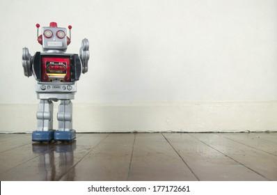 retro robot on wooden floor