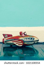 retro rocket toy on wooden floor  with reflection
