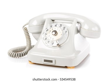 Retro rotary phone isolated on a white background. Vintage object.