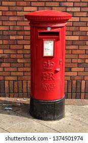 retro Royal Mail red pillar box, Castleford, Yorkshire, England, UK, 04/18/2019.