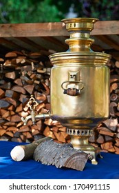 The retro russian  samovar with woods on a summer day