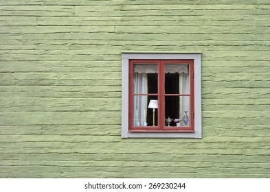 Retro Scandinavian Facade Window.  Old green retro colors at outdoor museum in Sweden.