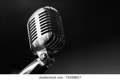 retro silver microphone on black background