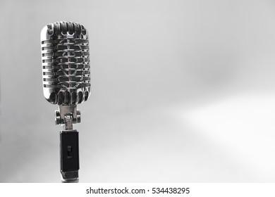 Retro silver microphone in White Studio