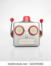 retro silver robot head on white