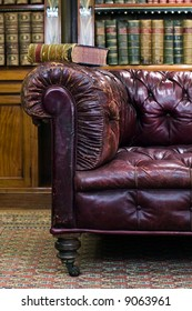Retro sitting room with leather couch with book on it