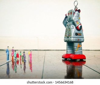 retro siver robot talkes to a small crowd  on a old wooden floor