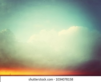 Retro sky and clouds. Analog photo with light leaks.