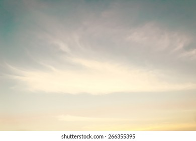 Retro sky with soft clouds on wind movement at sunset