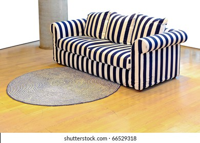 Retro Sofa With Navy Stripes Pattern In Empty Interior