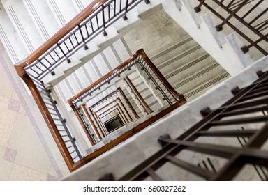 Retro spiral stairwell going down multiple flights