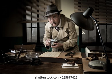 Retro spy agent caught photographing important documents on office desk, 1950s style.