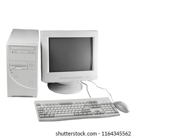 Retro stationary computer isolated on white background. Monitor, system unit, computer mouse. Obsolete Technologies