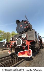 retro steam train on blue sky background