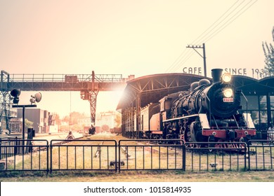 Retro steam train waiting at the train station.