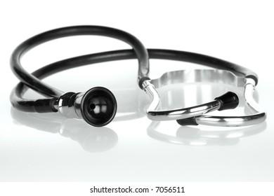 Retro stethoscope on white reflective translucent background