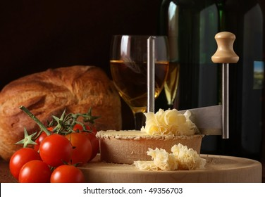 Retro Still life of Swiss Cheese Specialty Tete de Moine in low key tone