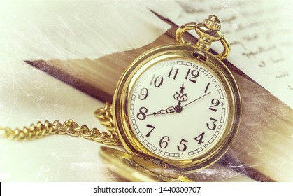 Retro still life with vintage golden pocket watch, book and handwritten letter