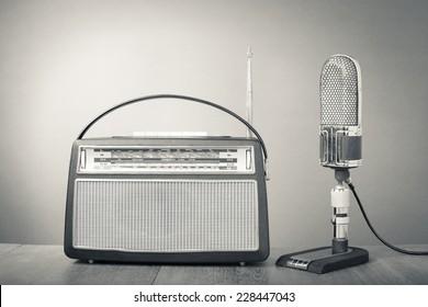 Retro studio ribbon microphone and radio receiver. Vintage old style greyscale photo