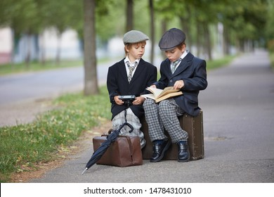retro style boys read a book in park waiting travel