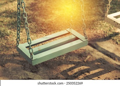 Retro style empty chain swing.