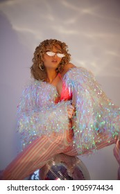 Retro style fashionable woman with disco ball