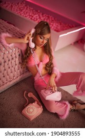 Retro style fashionable woman in pink