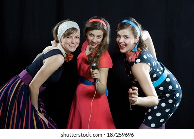 Retro style girl singing front of microphone