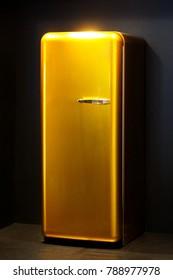 Retro style golden fridge in black kitchen