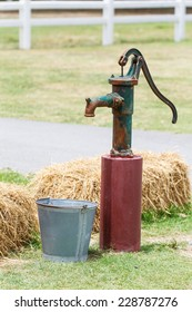Retro style hand water pump (old water pump)