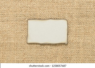 Retro style label over burlap cloth with copy space for your text.