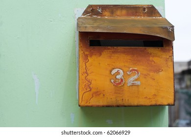 Retro style letterbox against wall with number
