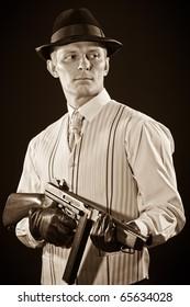 Retro style - Man keeps a submachine gun in sepia tone