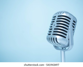 Retro style microphone  on light blue background