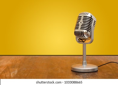 Retro style microphone recorder in studio with yellow background