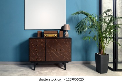 Retro style music station on drawers cabinet in blue walls room