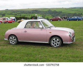 A retro style Nissan Figaro at a classic car show in west Wales, UK during the summer of 2011.