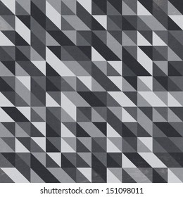Retro style pattern design made up of lots of colorful squares and triangles.