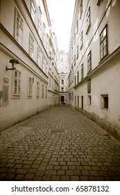 Retro style photo of old european town street