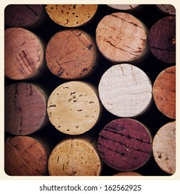 Retro style pink wine cork background. Cross processed to look like an aged instant photo.