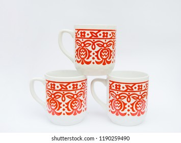 Retro style porcelain mug with red folk pattern - old tableware isolated