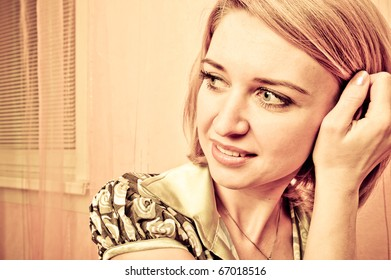 Retro style Portrait of a fresh and lovely woman looking side and fingers her hair